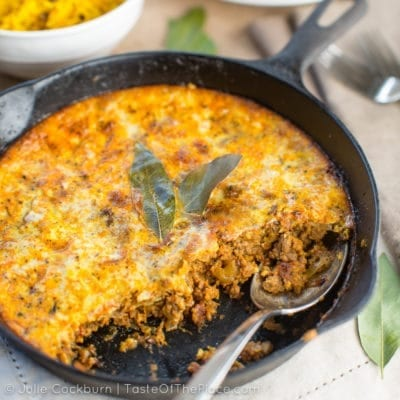 This classic dish from South Africa, Bobotie (pronounced ba-bo-tea), is made with ground beef seasoned to perfection, and a creamy, decadent topping. It is rich, savory, spicy, aromatic, and zingy. A comforting meal, full of the flavors of Africa!
