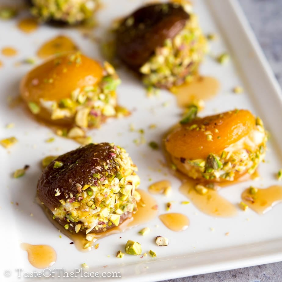 Beautiful Turkish dried apricots are soaked, candied with lemon scented syrup, stuffed with rich cream, and garnished with crunchy pistachios to make the perfect, lightly sweet one bite treat! Serve them after dinner, as an appetizer, for afternoon tea, or even for breakfast.