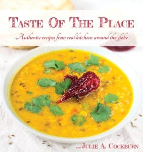 Cover image of the Taste Of The Place cookbook featuring the beautiful Indian soup, Dal Panchmela