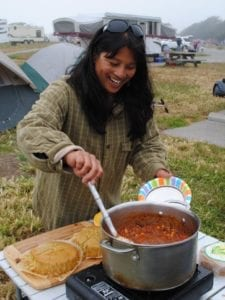 Camilla Mann cooking a feast for the camp